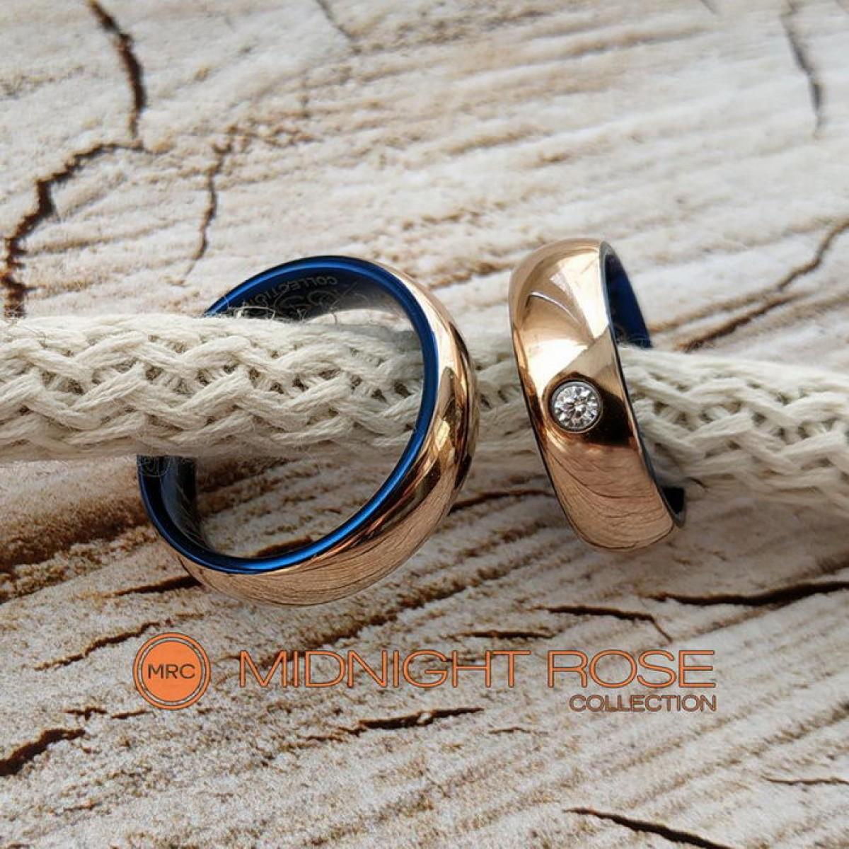 Золотые вольфрамовые обручальные кольца с камнем фото